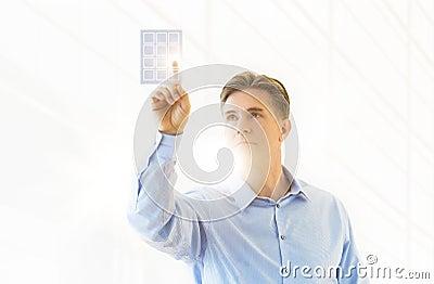 Mature Businessman Touching Virtual Keypad