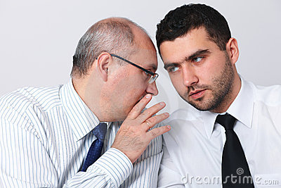 Mature businessman whisper something to colleague