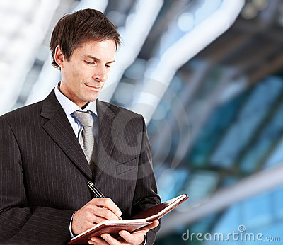 Mature businessman writing