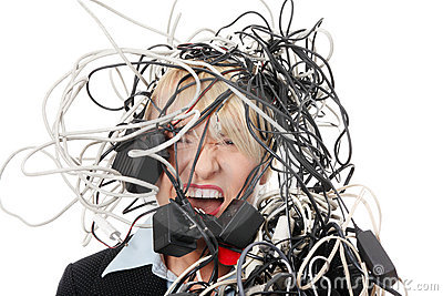 Mature businesswoman s screaming in cables.