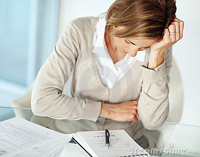 Mature businesswoman in tension with hand on head