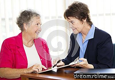 Mature Businesswomen Discuss Contract