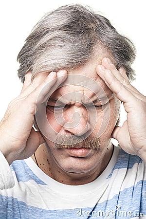 Mature caucasian man having very strong pain