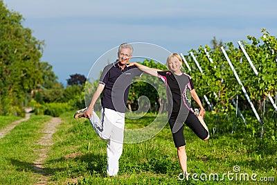 Mature couple doing sport outdoors