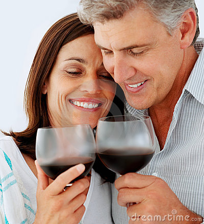 Mature couple drinking a glass of wine together