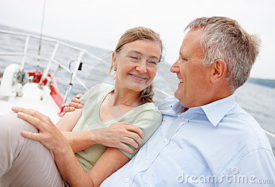 Mature couple enjoying on a boat while on a voyage