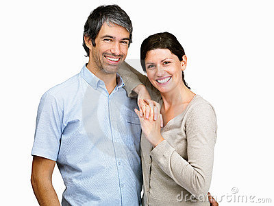 Mature couple giving you a warm smile on white