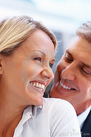Mature couple happily laughing together