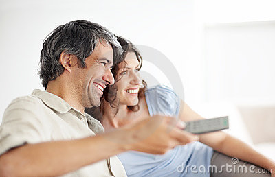 Mature couple at home enjoying a television
