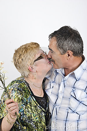 Mature couple kiss