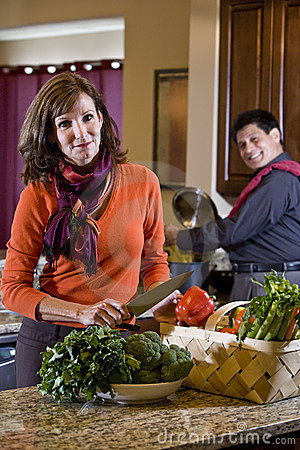 Mature couple in kitchen preparing healthy dinner