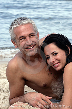 Mature couple relaxing on the beach