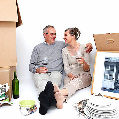 Mature couple relaxing after moving house