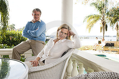Mature couple relaxing on terrace