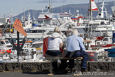 Mature Couple At Reykjavik's Old Harbor Editorial Stock Photo