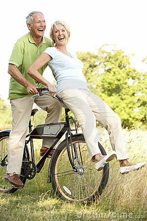 Free Mature Couple Riding Bike In Countryside Stock Photos - 10972153