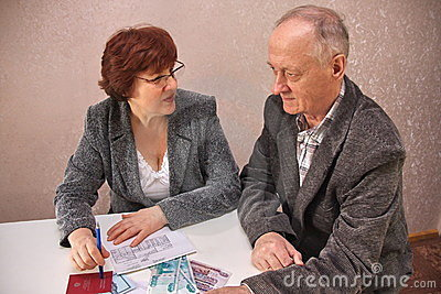 Mature couple sitting at a table
