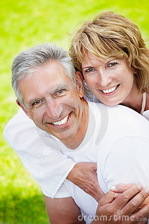 Free Mature Couple Smiling And Embracing Stock Photos - 18898733
