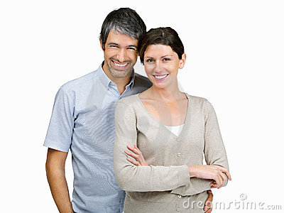 Mature couple smiling on white background