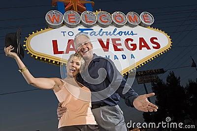 Mature Couple Standing Against  Las Vegas  Sign
