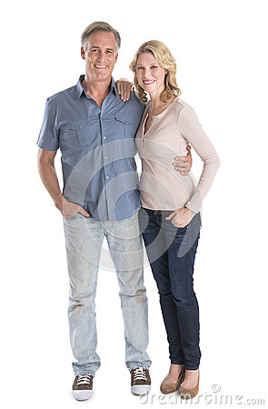 Free Mature Couple Standing With Hands In Pockets Royalty Free Stock Photography - 32429997