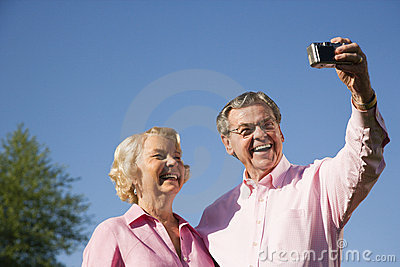 Mature couple taking picture.