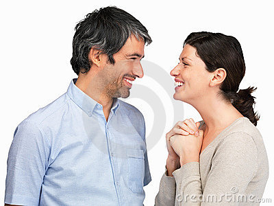 Mature couple talking to each other against white