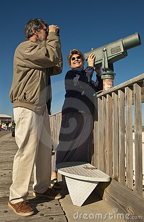 Mature Couple with Telescope and Binoculars
