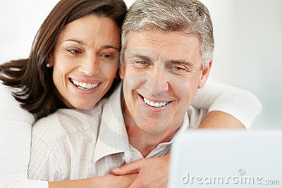 Mature couple using internet on laptop computer