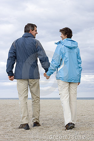 Mature couple walking on a beach
