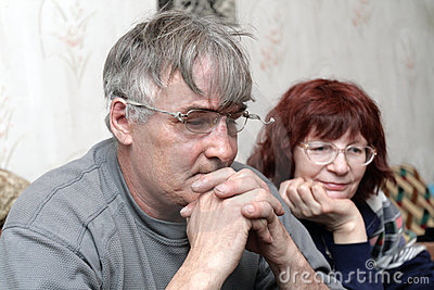 Mature couple watching TV