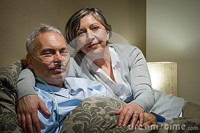 Mature couple wife supporting ill husband