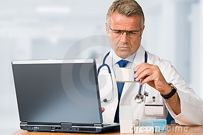 Mature doctor check some medicines
