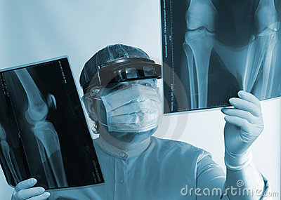 Mature doctor examining X-ray image