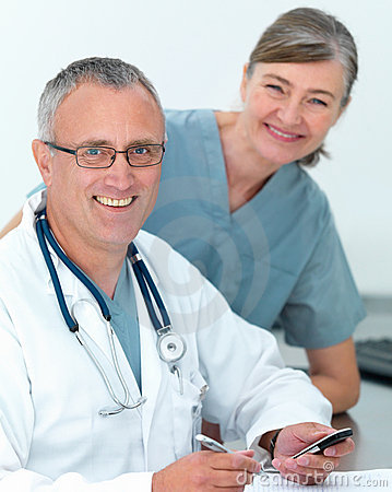 Mature doctor and nurse ready to help you