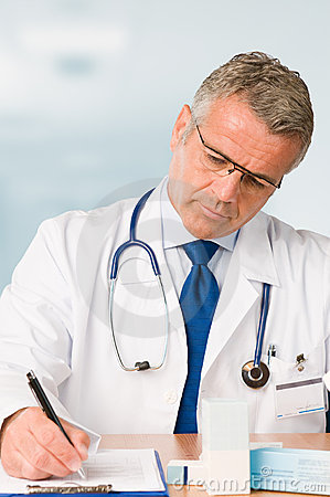 Mature doctor prescribes medical exam