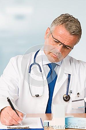 Mature doctor prescribes medical exam