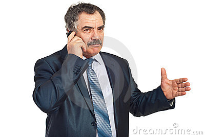 Mature executive give explanations at phone