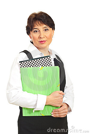 Mature executive holding folders