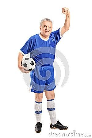 Mature fan wearing a sport wear holding a football