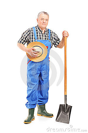 Mature farmer holding a shovel