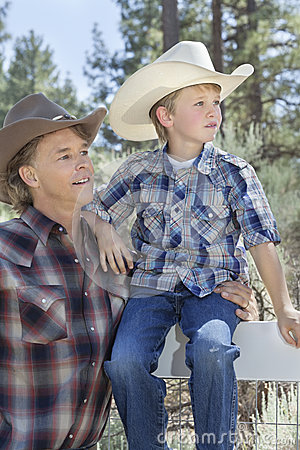 Free Mature Father And Son Wearing Cowboy Hats Looking Away In Park Stock Photos - 30851763