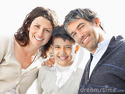 Mature father and mother with their little son