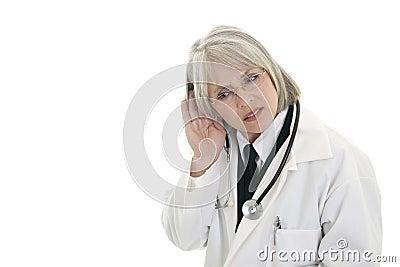 Mature female doctor listening