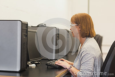 Mature female student in computer class