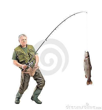 Mature fisherman catching a fish