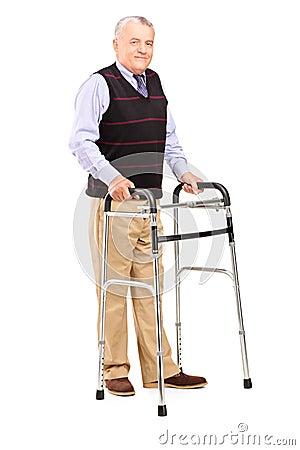 Mature gentleman using a walker