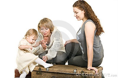 Mature grandmother, young mother and daughter