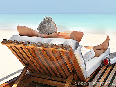 Mature guy relaxing at the beach