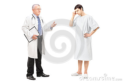 Mature health specialist talking to a worried patient